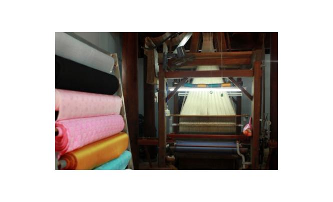 traditional silk weaving loom and silk material in Van Phuc