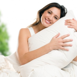 Woman hugging a Silksleep pillow